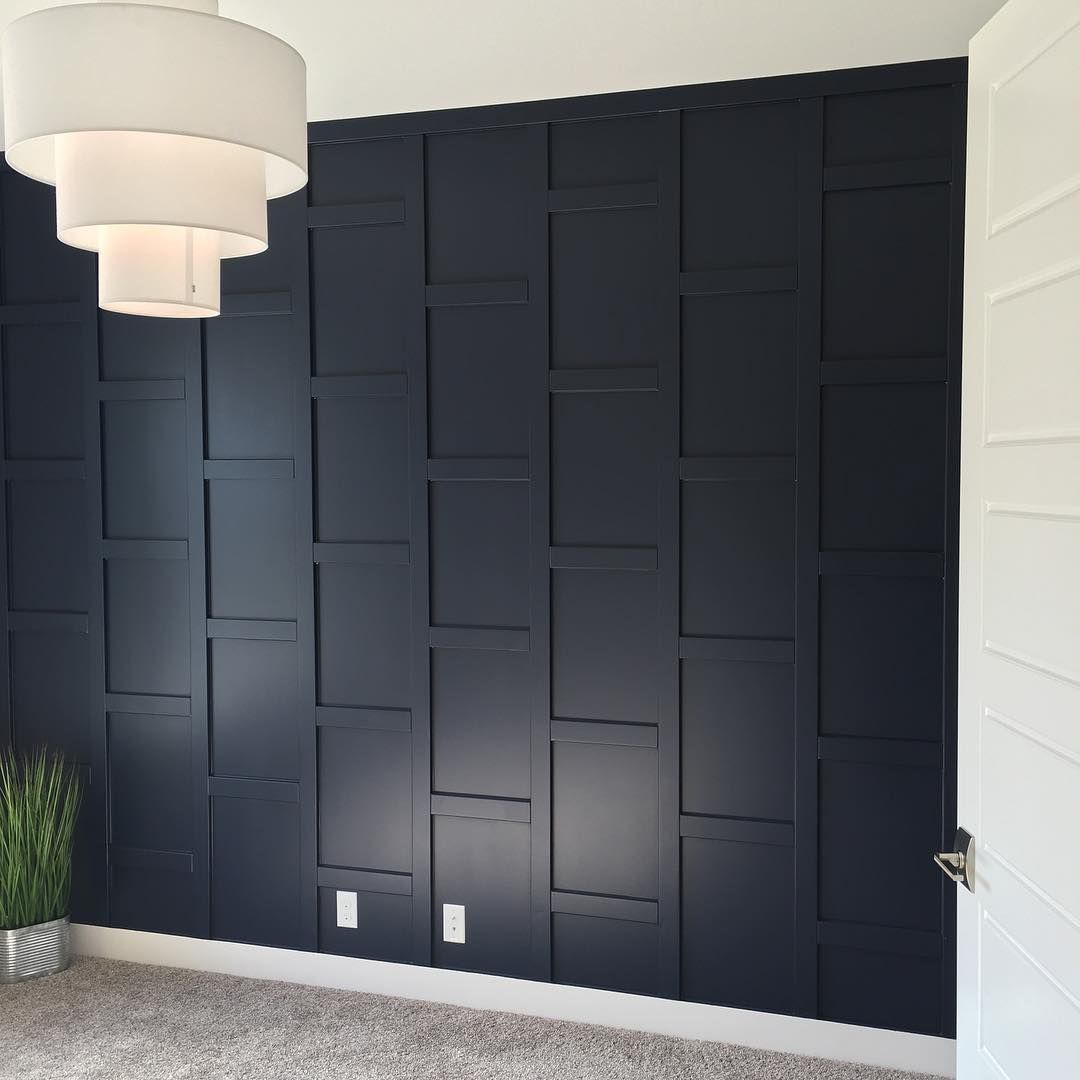 Navy Blue Is Everywhere And We Incorporated It Throughout This Home Can T Wait To See This Den Fully Dec Wooden Accent Wall Blue Accent Walls Wood Accent Wall