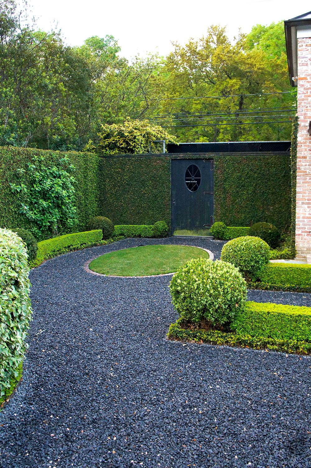 Behind The Private Driveway Is A Blackstar Gravel Path Leading To