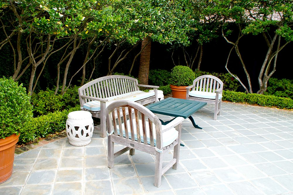 Blue and white striped cushions are found throughout patio