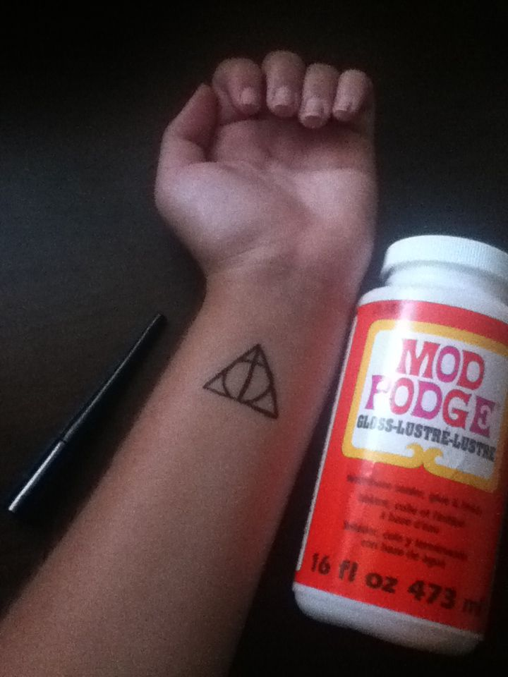 Temporary Tattoo Used With Liquid Eyeliner And Covered With Mod