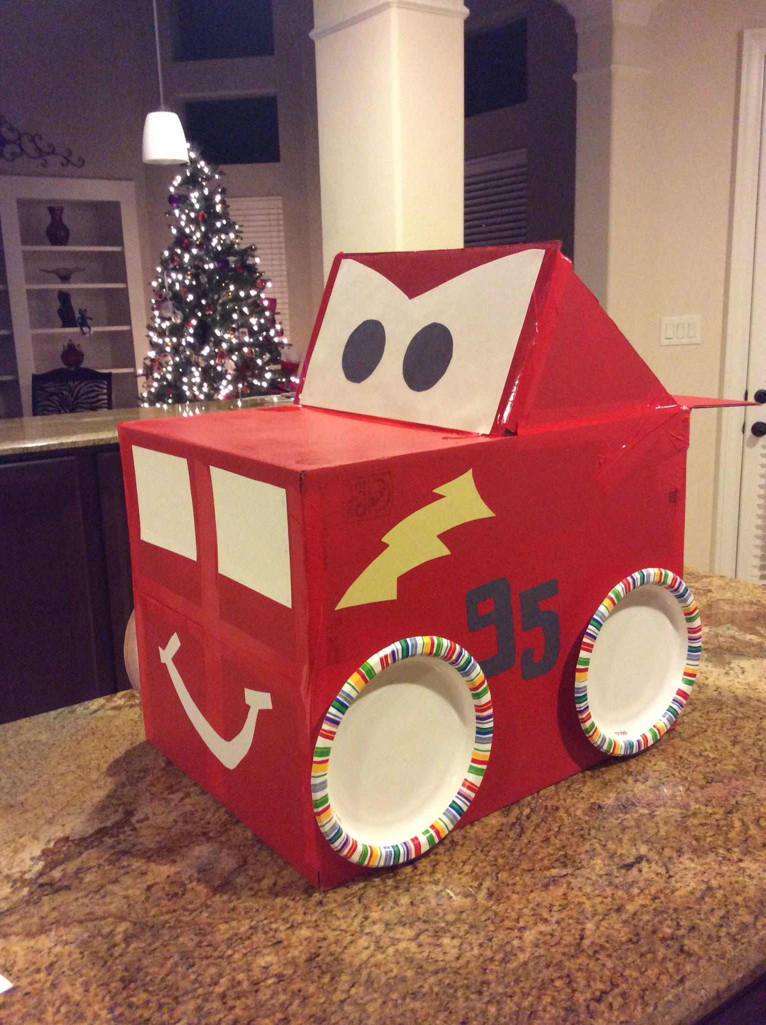 Lightning McQueen car made out of a cardboard box paper plates