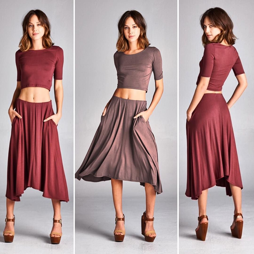 D5616 A two-piece set. Top is fitted round neck elbow length sleeves crop top. Bottom is loose fit asymmetrical hem below the knee length skirt. There is elastic at waist. Has side seam pockets on skirt. This two-piece set is made with heavyweight knit jersey that is very soft drapes beautifully and stretches very well. This fabric is not sheer.  #cherishusa #cherishapparel #shopcherish #springfashion #fashionbuyer #boutique #fashion #fashiondiaries #instafashion #instastyle #fashionstyle…