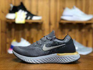 d429c097c694 Nike Epic React Flyknit Grey Black Gold AQ0067 009 Mens Running Shoes