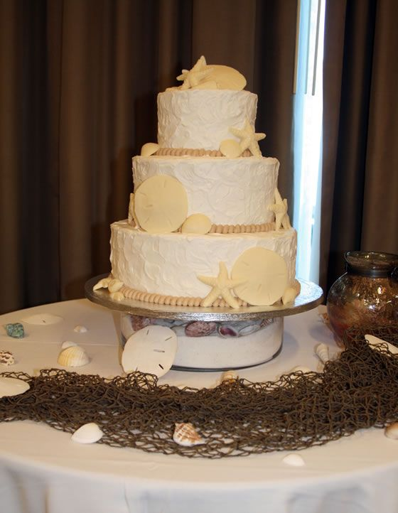 The Perfect Cake For A Beach Wedding By Freedom Bakery And Confections Cream Wedding Cakes Beach Wedding Cake Wedding Cake Bakers