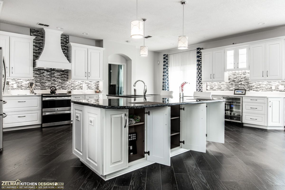 This kitchen island is constructed entirely out of Waypoint cabinets to give extra storage for the whole family.  Dream kitchen!  Visit https://www.zelmarkitchendesigns.com for more design ideas.