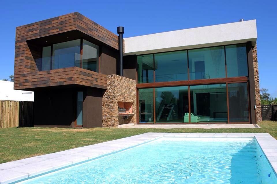 Modern house bazzurro arquitectos residencia moderna for Casa moderna 99 arena
