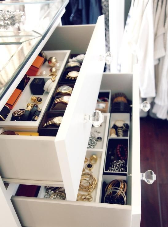 White Closet Dresser With A Gl Top Accented Round S Features Drawers That Pull Out Tor Reveal Jewelry Organized In Trays