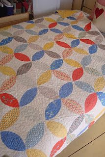 A pretty quilt. The most inviting beds, to me, are covered in pretty quilts.