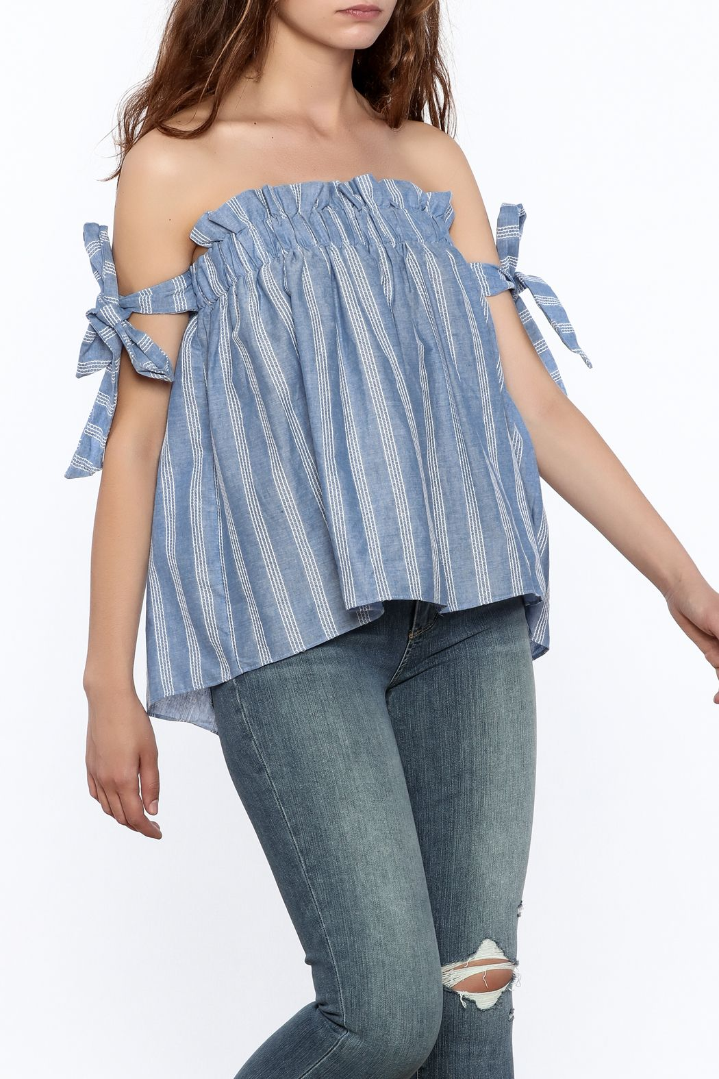 db4045dbd4a9b Blue boxy top with white stripe print detail and off-shoulder short  sleeves. Elasticized chest band and tie-up sleeves. Stripe Off Shoulder Top  by Do   Be.
