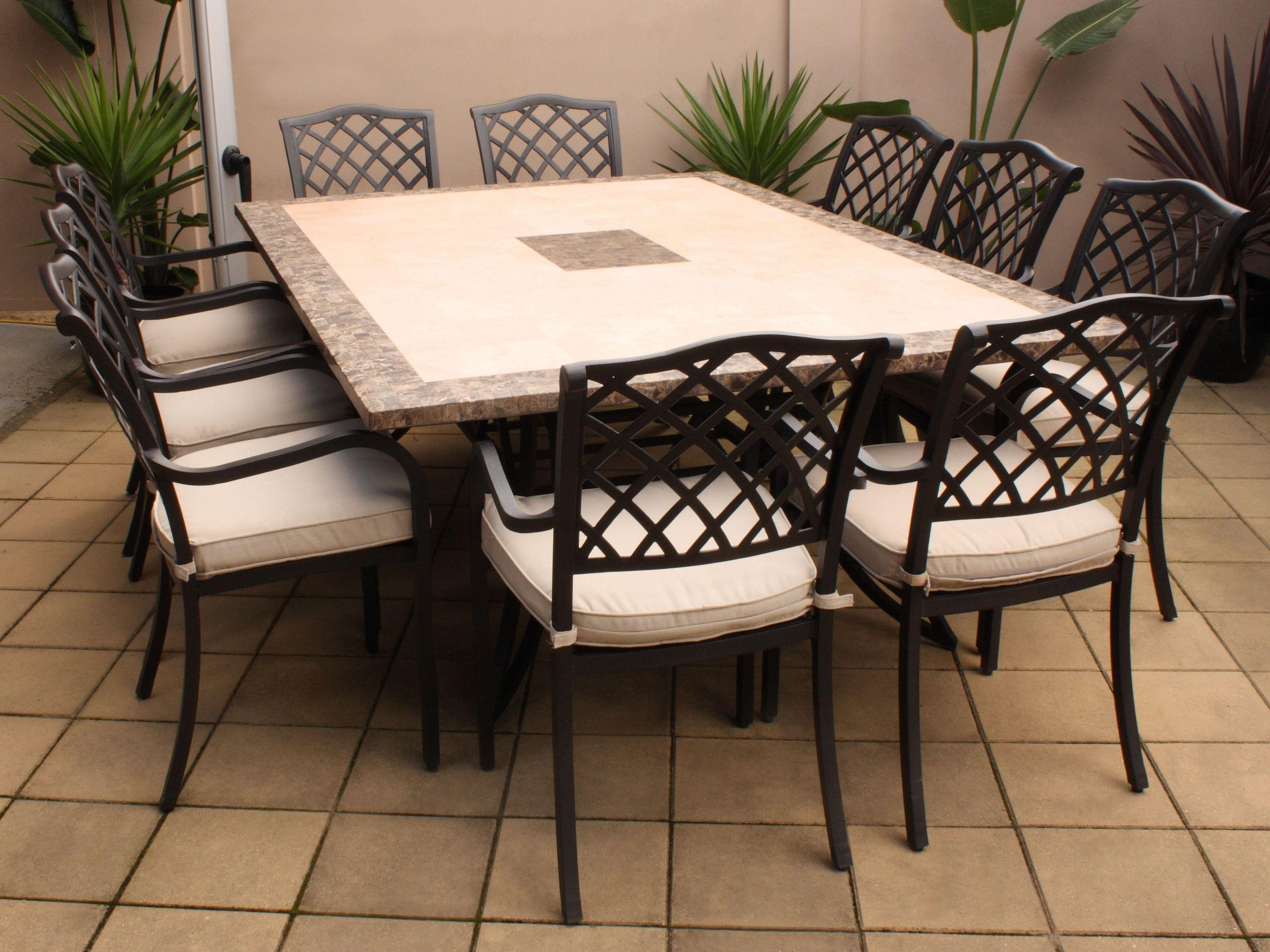 Furniture: Soft Brown Vinyl Floor Natural Lighting Outdoor Dining Room  White Upholstered Chairs Black Paint Metal Material Four Legs Strong Base  Large ...