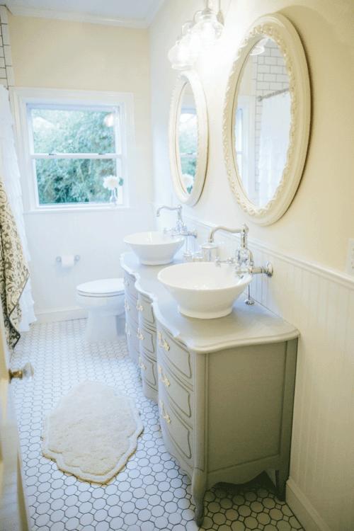 farmhouse style bathroom old dresser used as vanity sinks floors white tile