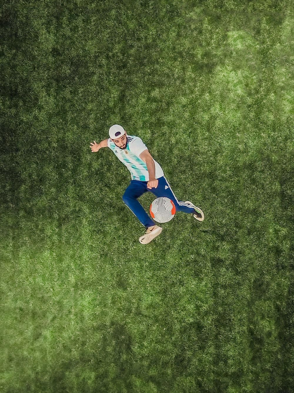 Aerial View Of Man Playing Soccer Ball On Grass Sports Sports