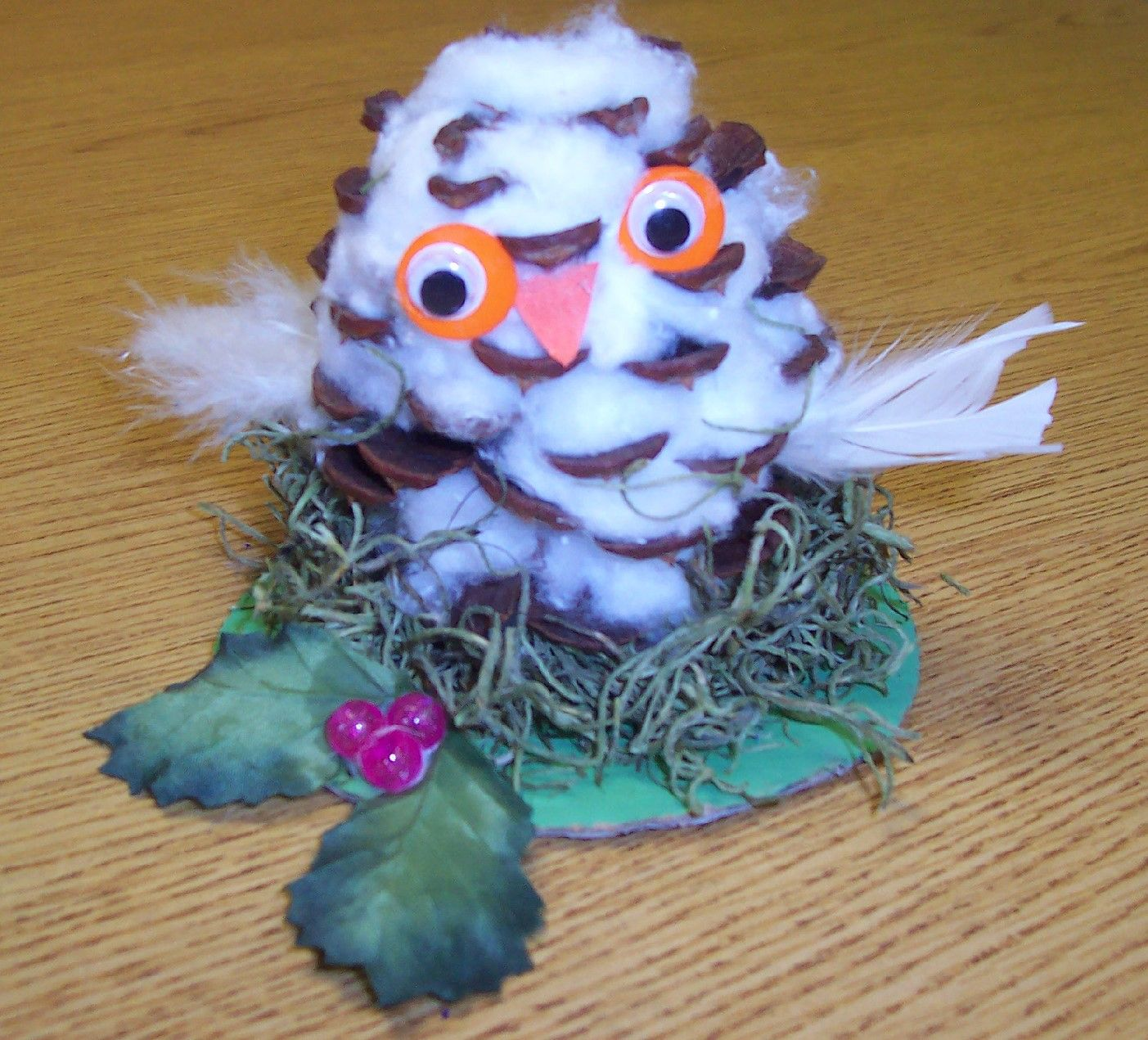 Snowy Owl craft - Create a pinecone snowy owl in a decorated moss nest.  Very kid friendly.  I read Jan Brett's, Animals' Santa, to my class before we made these.