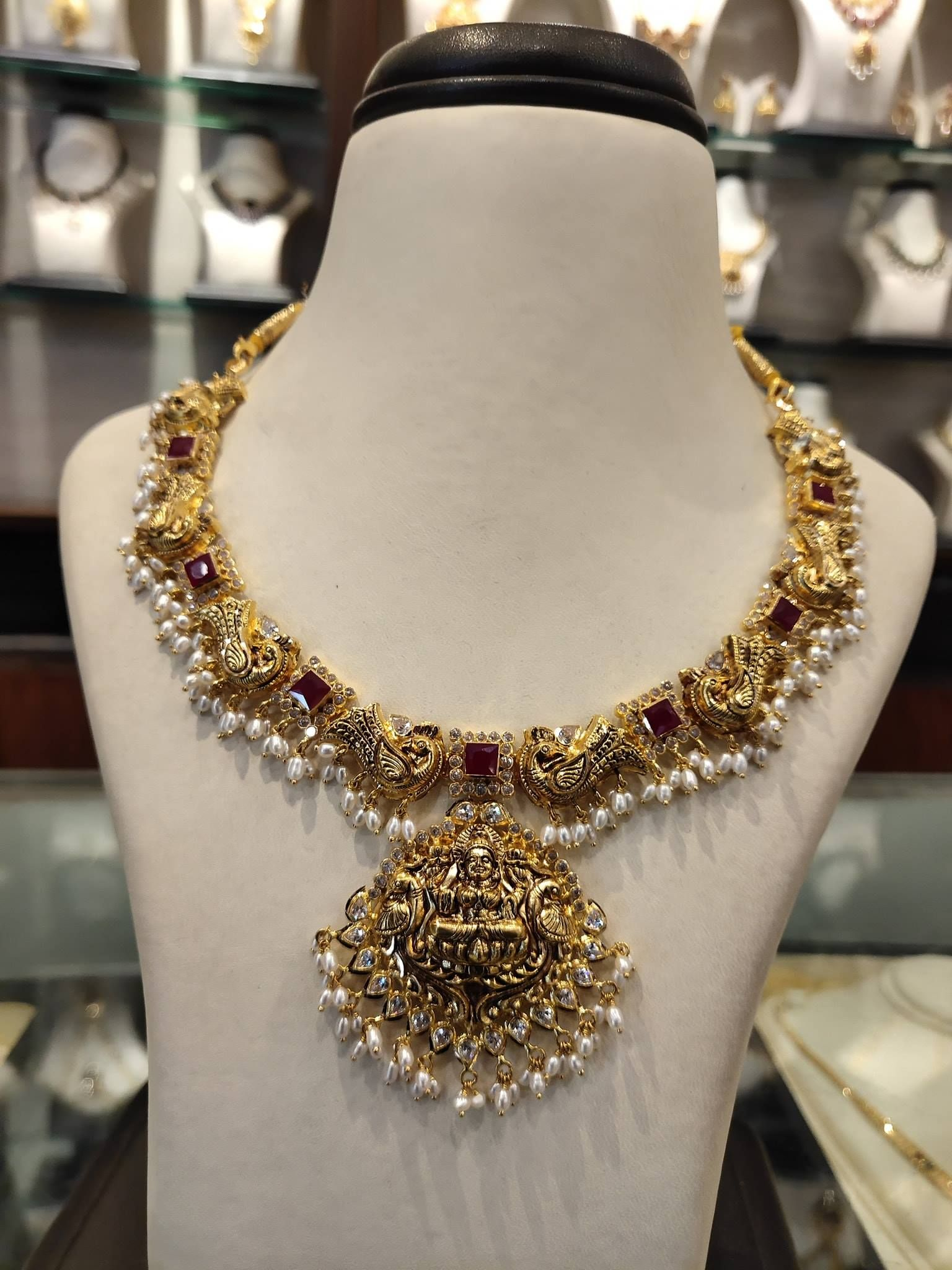 06f34c5c39f Stunning gold necklace in dancing peacock design. Necklace with Lakshmi  devi pendant. Necklace with rice pearl hangings. 17 August 2018. Light  weight ...