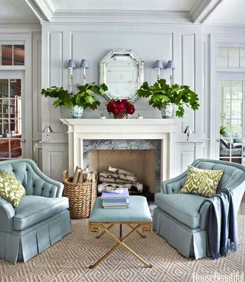 Cozy living room featuring a pr robin egg's blue chairs by the fireplace, lovely!.