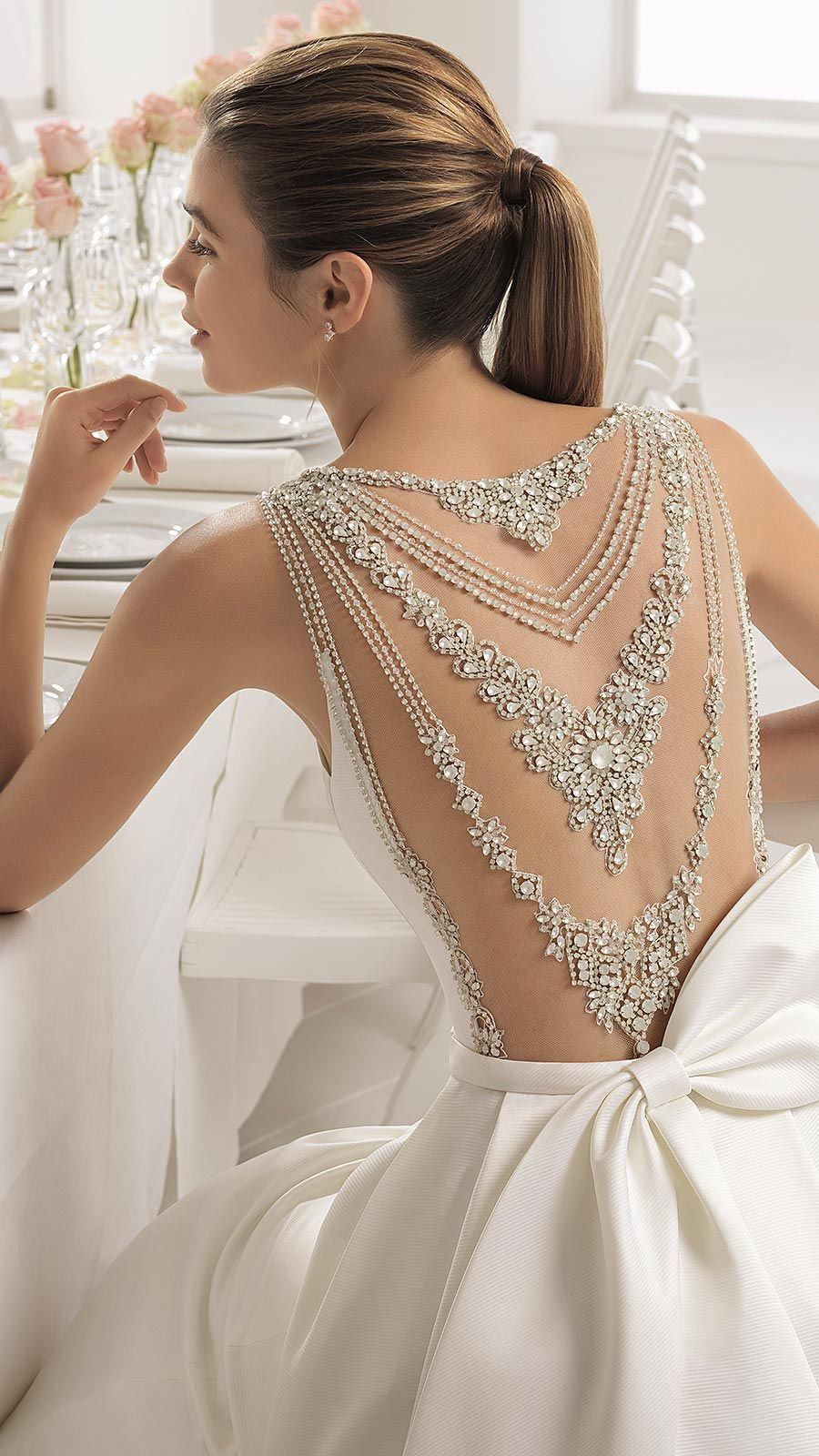 Wedding dress with bow on back  BOMBAY by Aire Barcelona Timeless with a modern twist this elegant