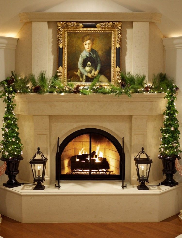 elegant beige marble mantel fire place with small christmas treeselegant beige marble mantel fire place with small christmas trees decoration and floor lanterns also string lights below picture frame