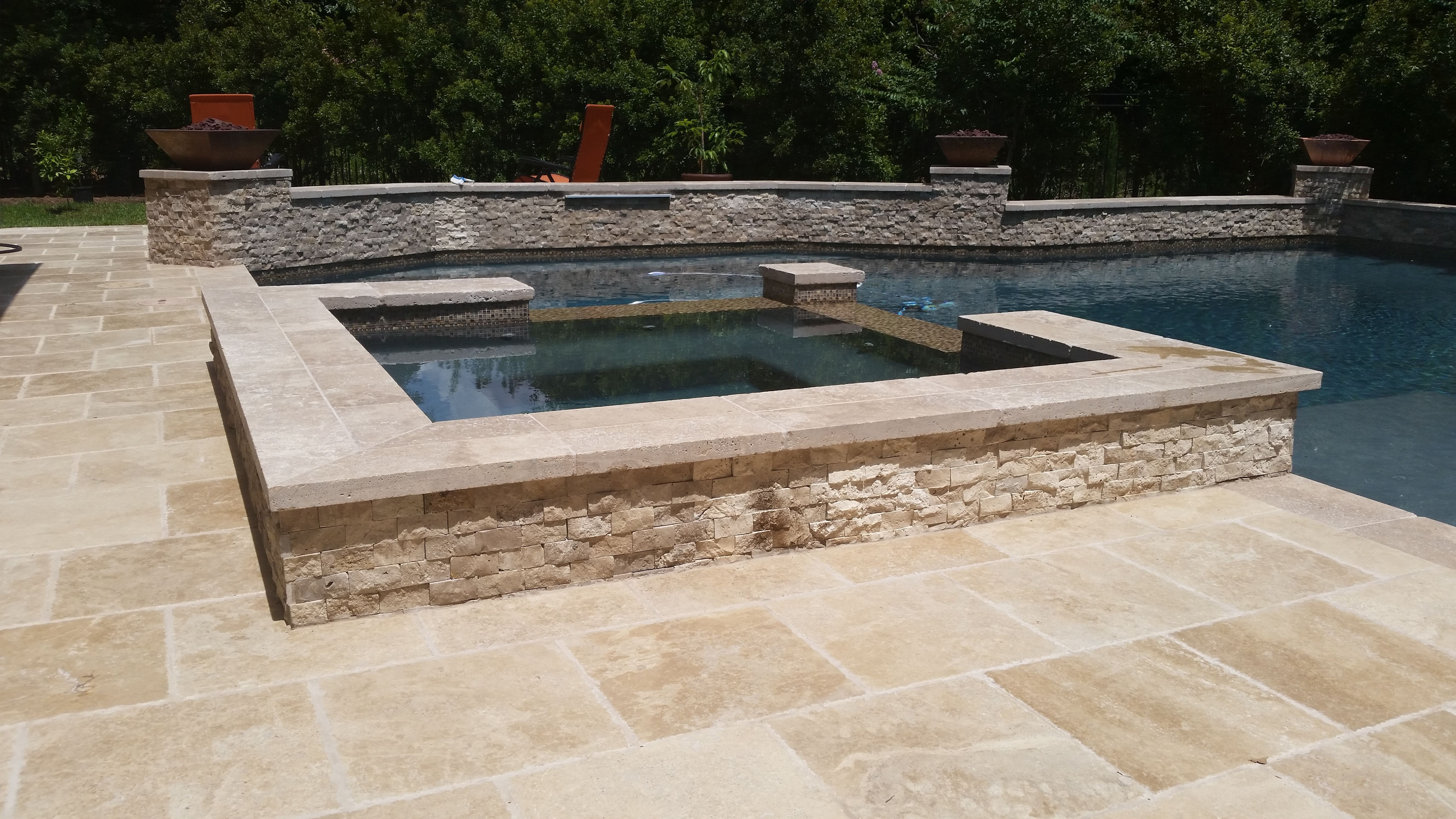 "12"" raised spa - travertine coping with a stacked travertine tile"