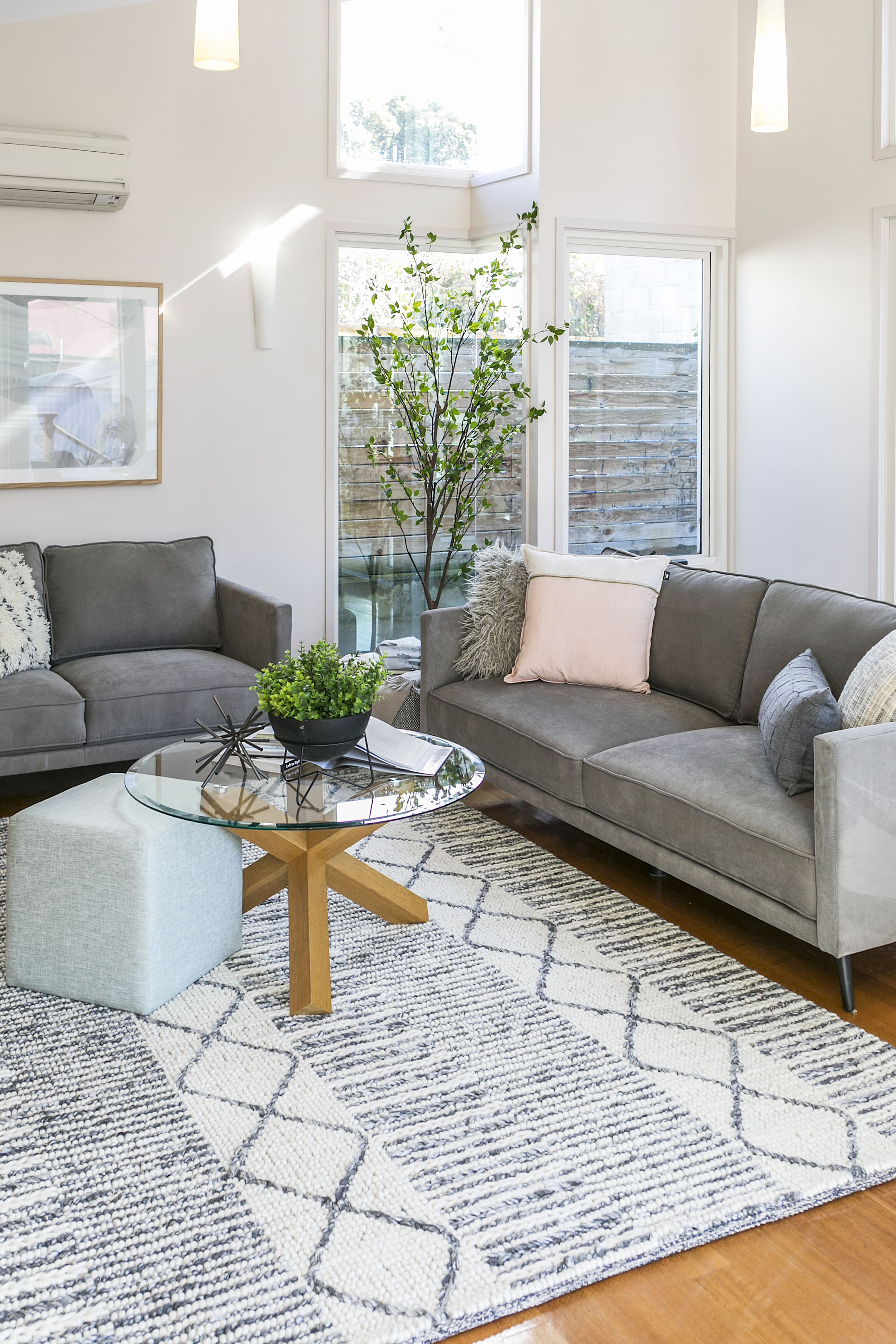 Textured Floor Rug Is The Hero In This Light Filled Living Room