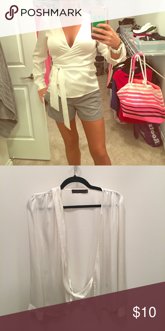 GORGEOUS wrap blouse! Soft, flowing, polyester cream blouse. Perfect for the day or night! The Limited Tops Blouses