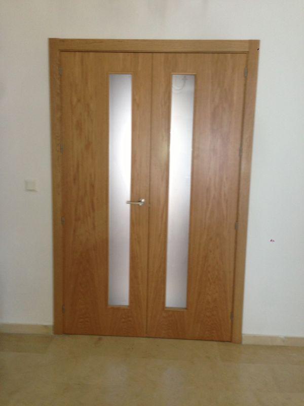 Puerta doble modelo l50 roble con vidriera vl1 cristal for Puerta doble madera