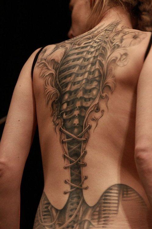 Gorgeous Cyborg corset tattoo - artist unknown #tattoo #ink #black #grey
