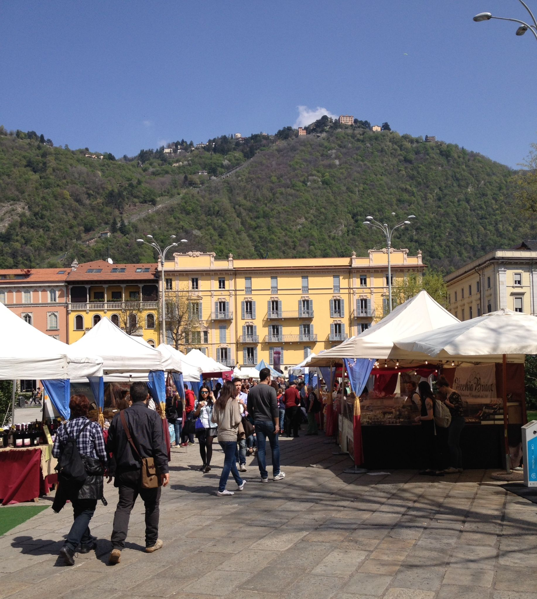 Outdoor market is set up in Piazza Cavour ~ Como, Italy