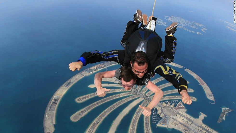 One Of The Best Views Of The Palm Jumeirah Is From The Air Skydive Dubai Offers Jumps From 13 000 Feet In Tandem Mean Dubai Buildings Dubai Adrenaline Junkie
