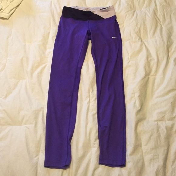Nike running tights Purple Nike running tights. Drawstring, mesh behind knees, reflective details on bottom of leg Nike Pants Leggings