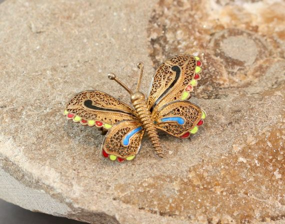 Antique 1930's French Enamel Butterfly Pin by Ringmakers on Etsy This adorable butterfly pin is an antique from the 1930s. It's hand crafted of brass and decorated with French enamel. It measures 38mm wide by 30mm tall (approximately 1 1/2 inches by 1 inch).