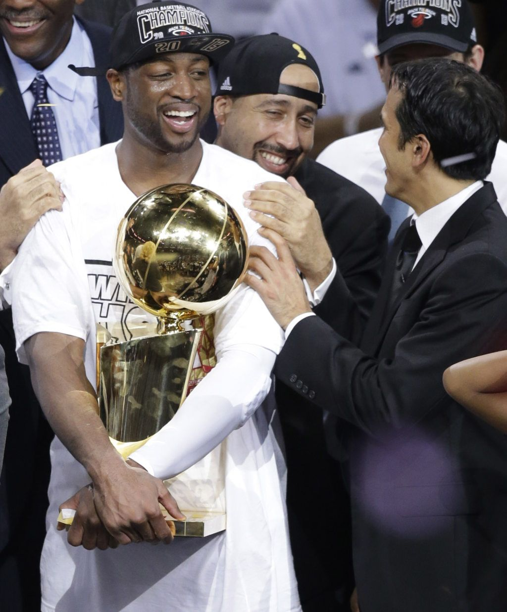 Coach Larry Wade Sweater: NBA CHAMPIONS: From Left, Miami Heat's Dwyane Wade Holds