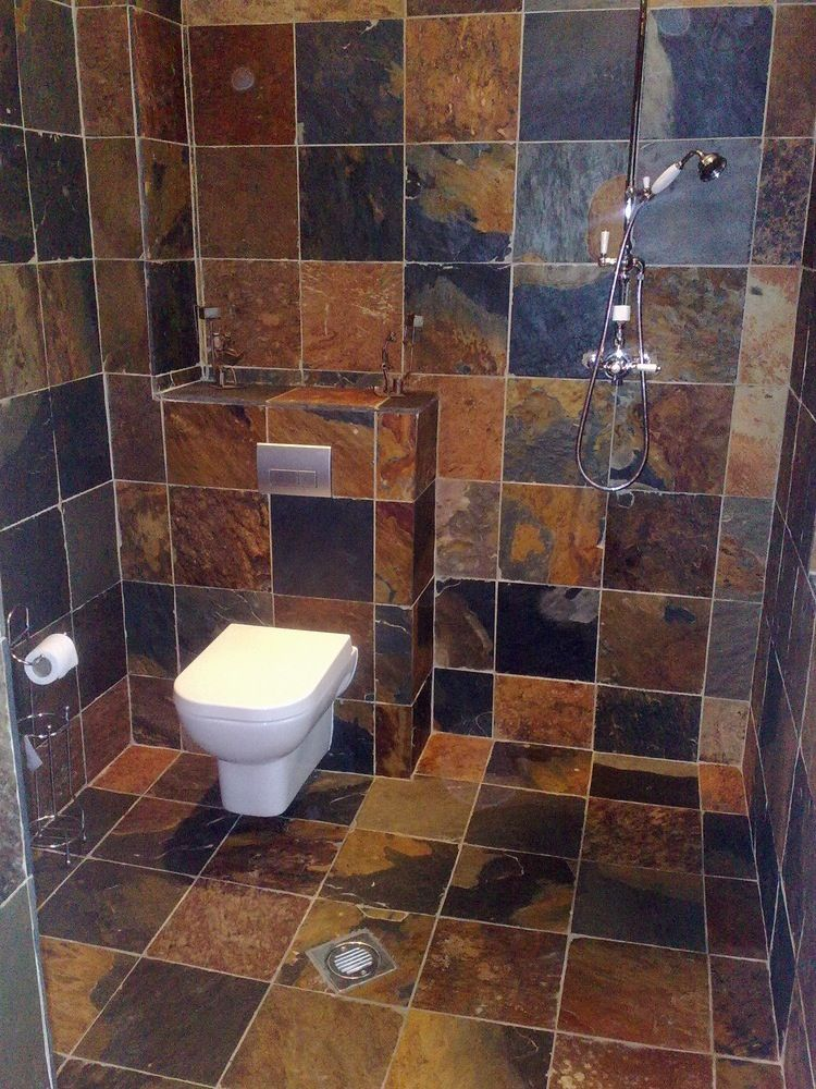 Indian slate tiling in bathroom shows off the deep brown