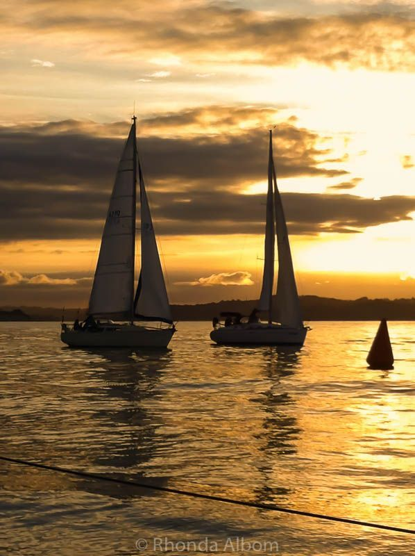 Sunset during a yacht race on the Hauraki Gulf just outside of Auckland in New Zealand. During summer twilight races are popular on Wednesday and Friday nights. #newzealand #yacht #sunset #race #yachtrace