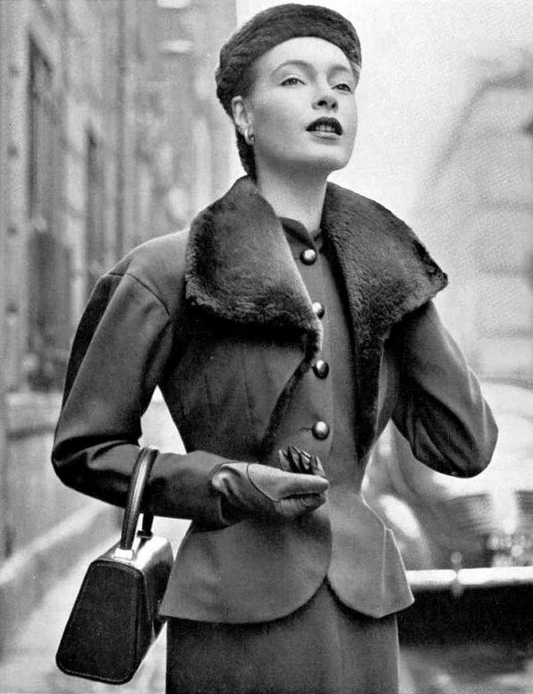 1951 Model in wool suit with large sheared beaver collar which gives it a bolero effect by Jacques Heim,