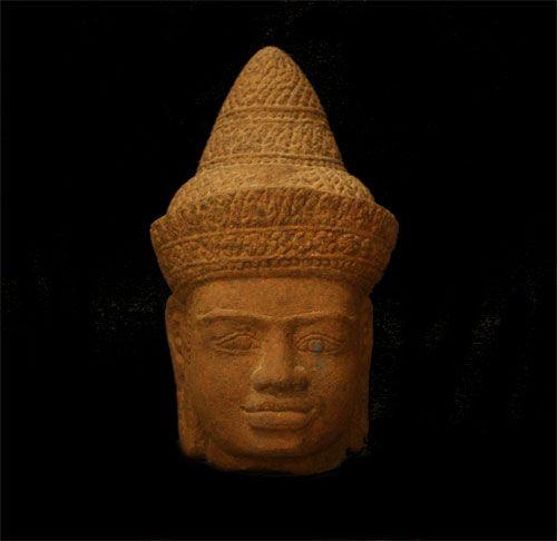 "Stone Head of a Buddha - SP.607 Origin: Cambodia Circa: 1150 AD to 1350 AD Dimensions: 7"" (17.8cm) high Collection: Buddhist Art Medium: Stone"