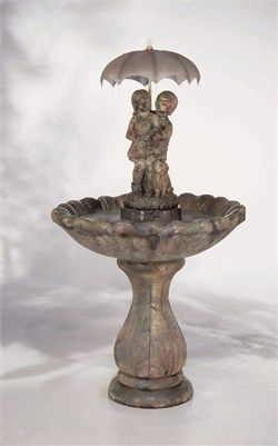 The Classic April Showers Fountain By Henri Studio Depicts Two