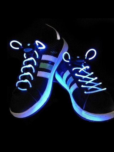 White LED Shoelaces on a black background on Adidas Shoes