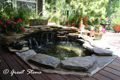 Goldfish pond on deck made from old hot tub repurposed for Koi pond temperature