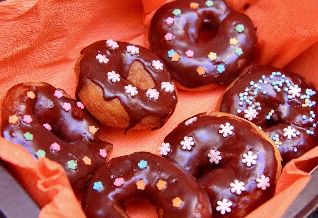 Doughnuts in chocolate glaze get it cooked chocolate