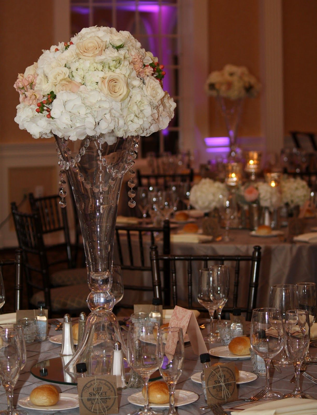 Tall vase wedding centerpieces reception table