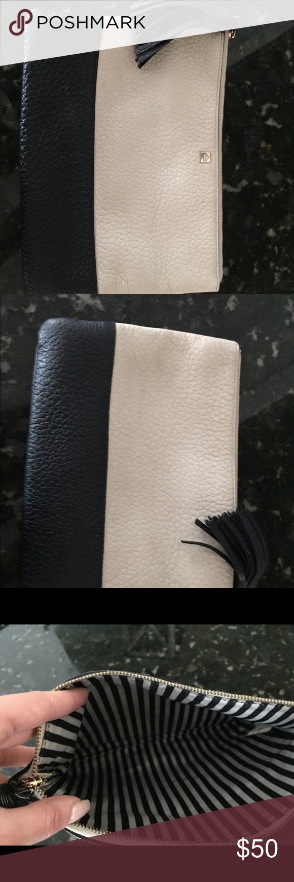 Kate spade clutch Black and cream Kate shade clutch. Used and light markings of use on the cream portion but can be easily removed with a leather wipe. Still in very good condition. Larger size clutch with black fringe tassel. kate spade Bags Clutches & Wristlets