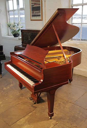 A 1926, Steinway Model M grand piano with a mahogany case and spade legs at Besbrode Pianos. Piano has an eighty-eight note keybaord and a two-pedal lyre.