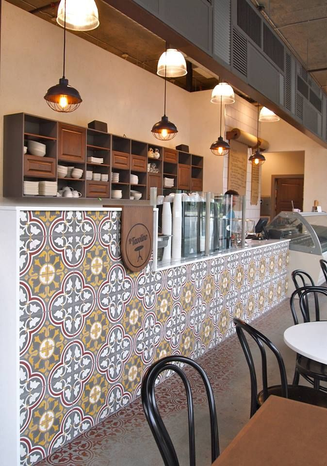 Cement Tile Shop - Roseton Red Pattern at Il Tavolino in Kelowna, British Columbia.  The restaurant is a collaboration between Maple Interiors and Hatch Interior Design.