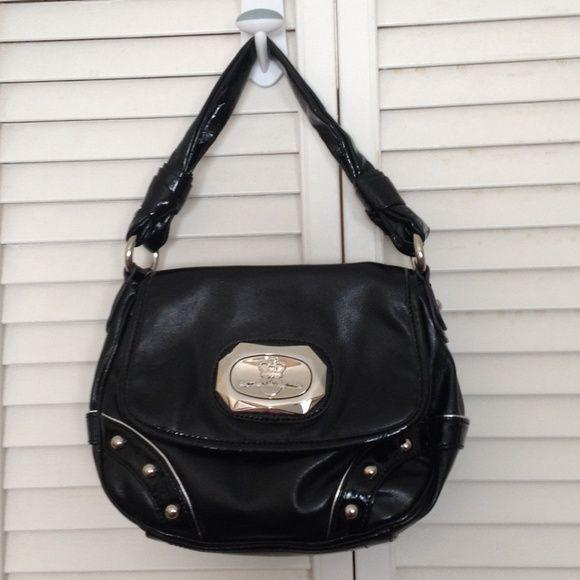 Black handbag by Kathy Von Zealand In good condition only worn a few times. No marks or wears.100% vinyl Kathy Van Zeeland Bags