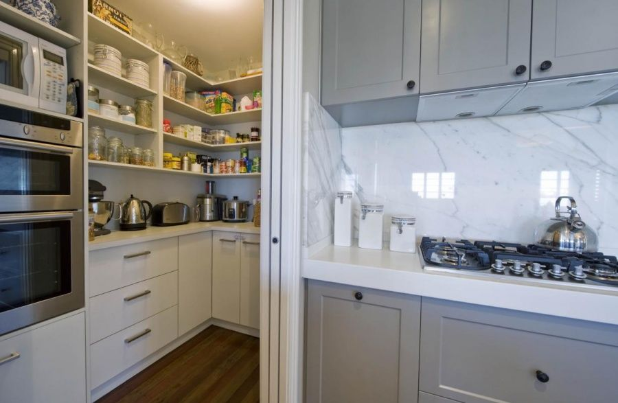 Kitchen with scullery - functional layout, oven and microwave tucked ...