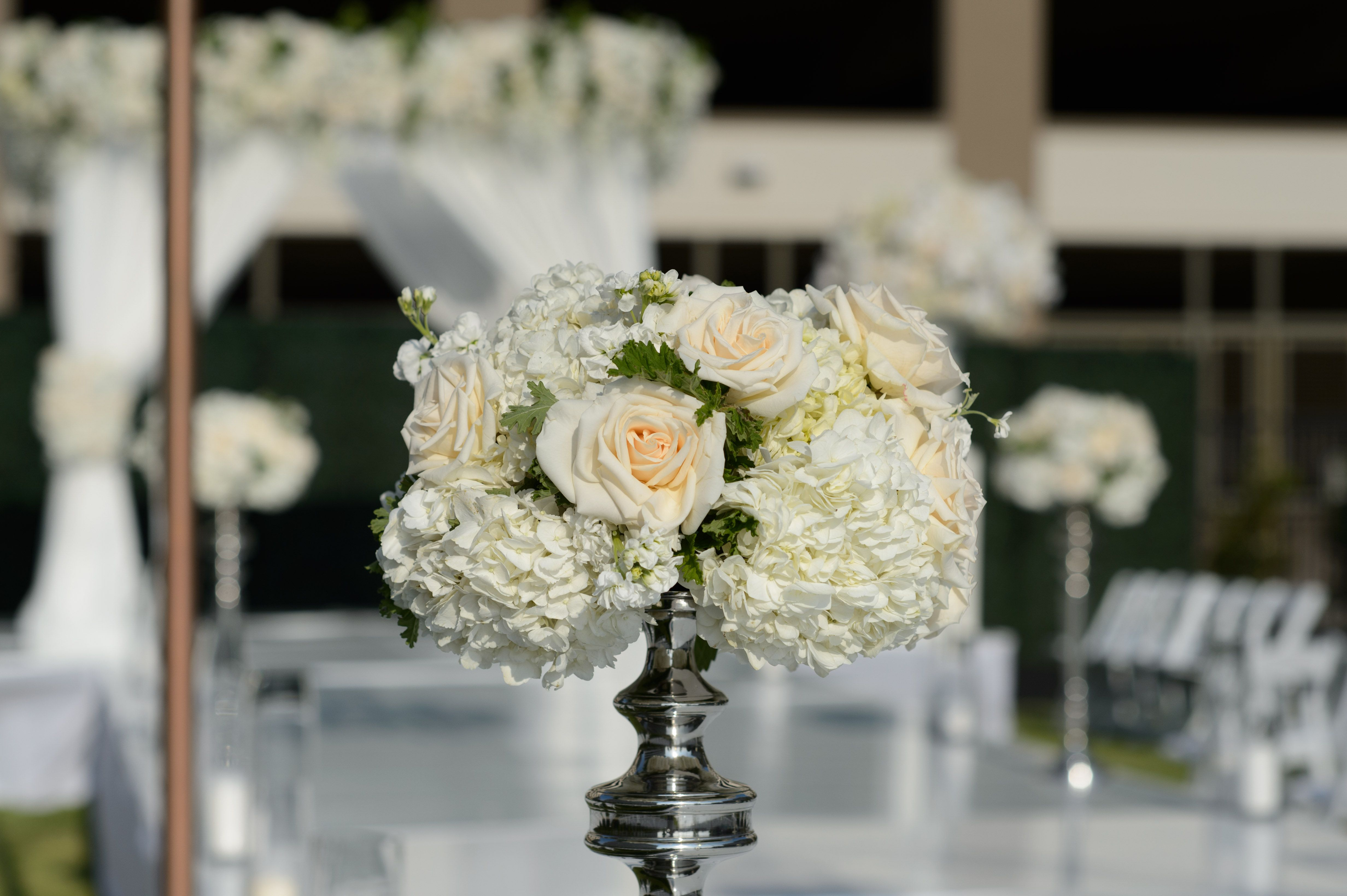 Outdoor wedding ceremony flowers on our event lawns