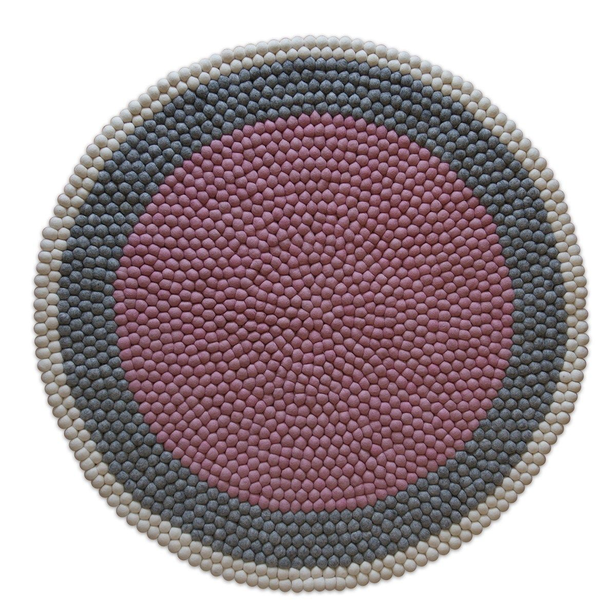 Our new Lottie rug has been inspired by our love of Scandinavian design.  With it's warm dusty pink inner circle and natural grey and cream outer rings, it's sure to make a statement in any home. The Lottie is super soft and stitched by using over 3,000 felt balls making it perfect for both adults and children alike.  Each of our rugs are handmade, which means every one of them is unique and no two are the same.  Please allow 1-2 weeks for delivery.  Sizes: 100cm, 120cm and 140cm (If you…