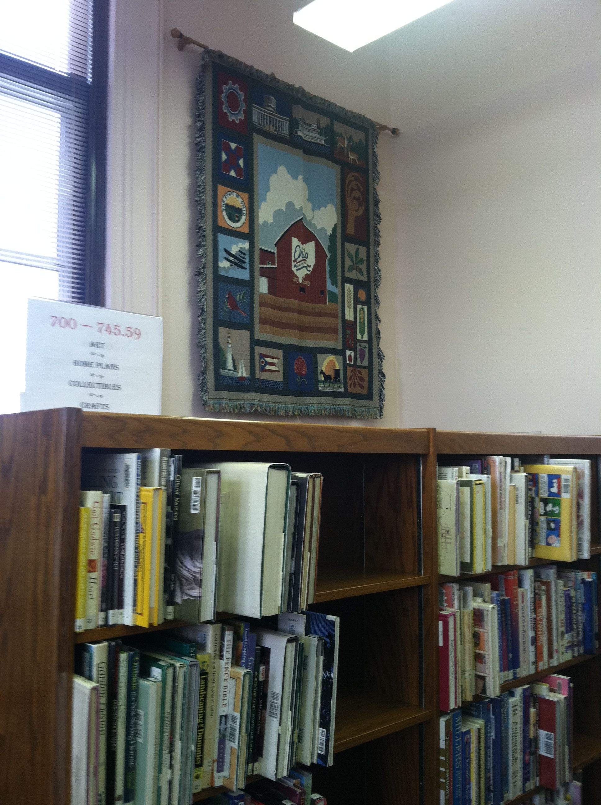 Hanging afghans on your library wall, especially with local or state significance, makes for a colorful display.