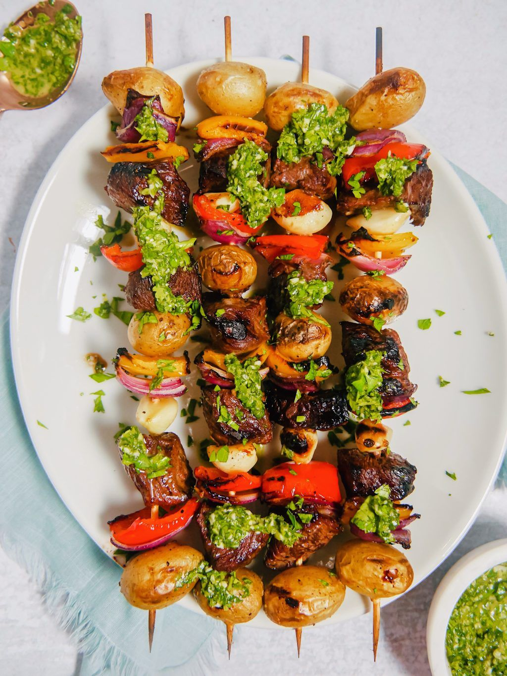 Marinated steak skewers with chimichurri girl with the