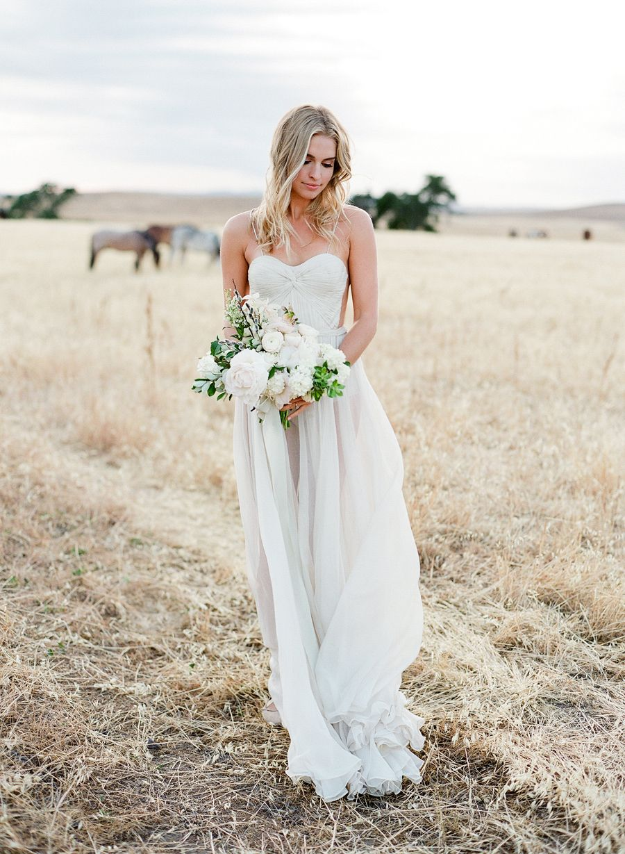 Wedding gown with red accents  Gossamer Gowns  Fields Filled with Horses ud the Ultimate